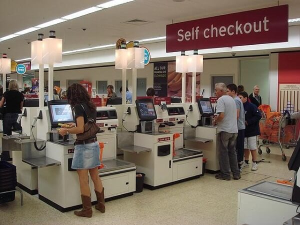 Self-service tills literally telling you to leave