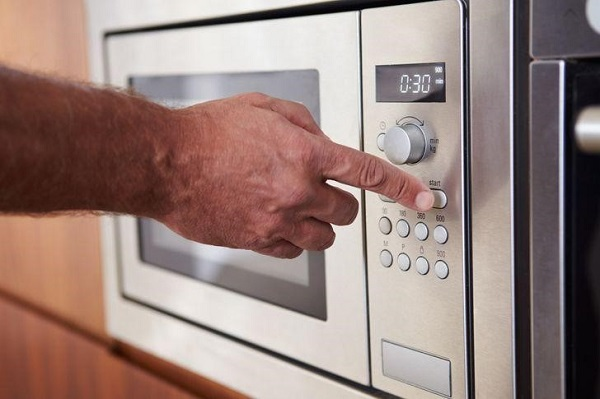Microwave with a mute button